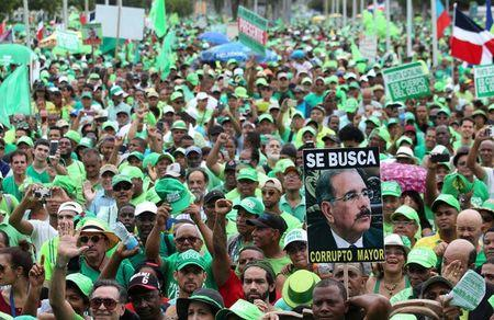 People march during a protest against corruption and the Brazilian conglomerate Odebrecht SA, in Santo Domingo