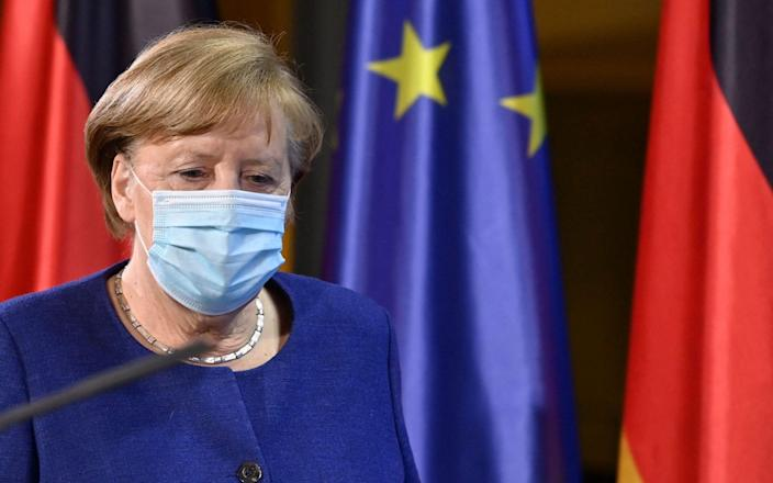 German Chancellor Angela Merkel arrives for a press conference following the EU leaders' videoconference in Berlin on February 25, 2021. (Photo by John MACDOUGALL / various sources / AFP) (Photo by JOHN MACDOUGALL/AFP via Getty Images) - JOHN MACDOUGALL/AFP