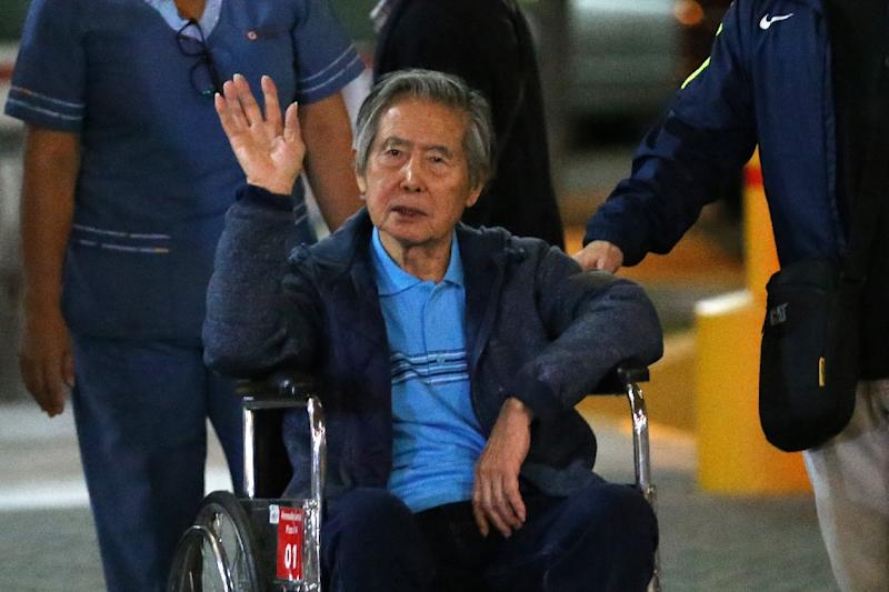 Peru's former President Alberto Fujimori, shown waving to supporters as he is wheeled out of the Centenario Clinic in Lima on January 4, now faces a new trial