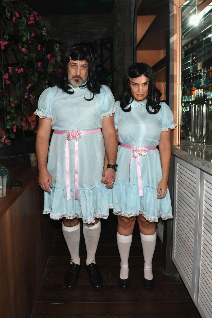 <p>Joey Fatone and girlfriend Izabel Araujo went for the ultimate creepy factor at a 2018 Casamigos Halloween party. The two matched in their adult-sized costumes replicating the twins from the movie <em>The Shining</em>. Even the facial expressions are perfect.</p>