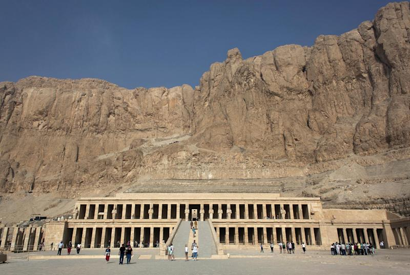 Foreign tourists visit Hatshepsut Temple, in Luxor, Egypt, Wednesday, Feb. 27, 2013. Nineteen people were killed Tuesday in what appeared to be the deadliest hot air ballooning accident on record. The tragedy raised worries of another blow to the nation's vital tourism industry, decimated by two years of unrest since the 2011 revolution that toppled autocrat Hosni Mubarak. The southern city of Luxor has been hit hard, with vacant hotel rooms and empty cruise ships.(AP Photo/Nasser Nasser)