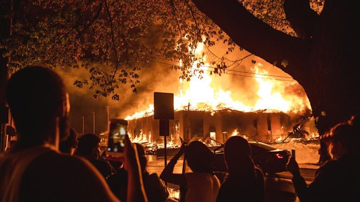Fires raged overnight close to the site where George Floyd was pinned down by police officers