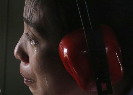 A typhoon survivor cries while evacuated by a military helicopter from Guiwan, Samar, that was among those areas battered by super Typhoon Haiyan in central Philippines