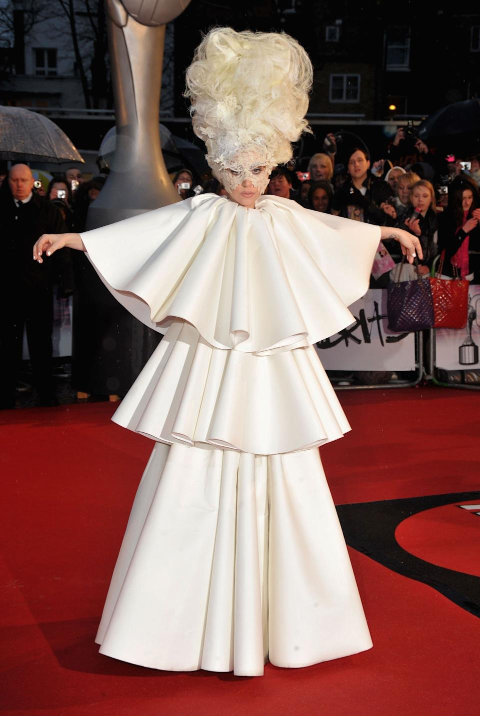 Gaga wears a gown by Francesco Scognamiglioon the red carpet at the 2010 Brit Awards.