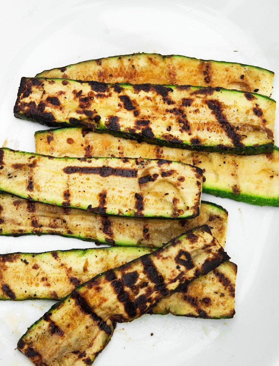 """<p>Here's your healthy, go-to summer side.</p><p>Get the recipe from <a href=""""https://www.delish.com/cooking/recipe-ideas/recipes/a53484/grilled-zucchini-recipe/"""" rel=""""nofollow noopener"""" target=""""_blank"""" data-ylk=""""slk:Delish"""" class=""""link rapid-noclick-resp"""">Delish</a>.</p>"""
