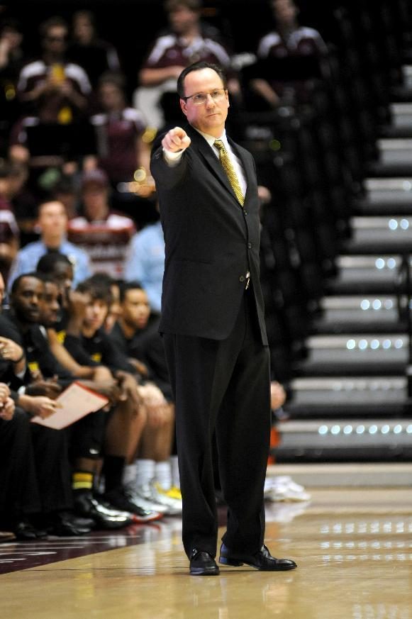 Wichita State head coach Gregg Marshall points to the corner while setting up a play against Southern Illinois during the first period of a Missouri Valley Conference NCAA college basketball game in Carbondale, Ill., Thursday, Jan. 2, 2014. (AP Photo/Stephen Lance Dennee)