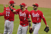 Cincinnati Reds' Eugenio Suarez (7) celebrates as he walks off the field with Nick Castellanos (2) after getting the final out of a baseball game against the Pittsburgh Pirates in Pittsburgh, Wednesday, May 12, 2021. The Reds won 5-1.(AP Photo/Gene J. Puskar)