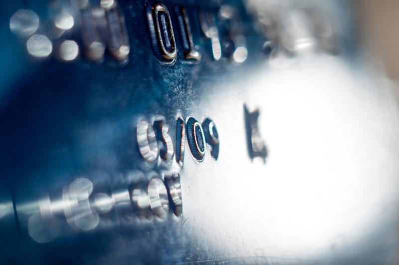 Close-up of a blue-colored credit card.