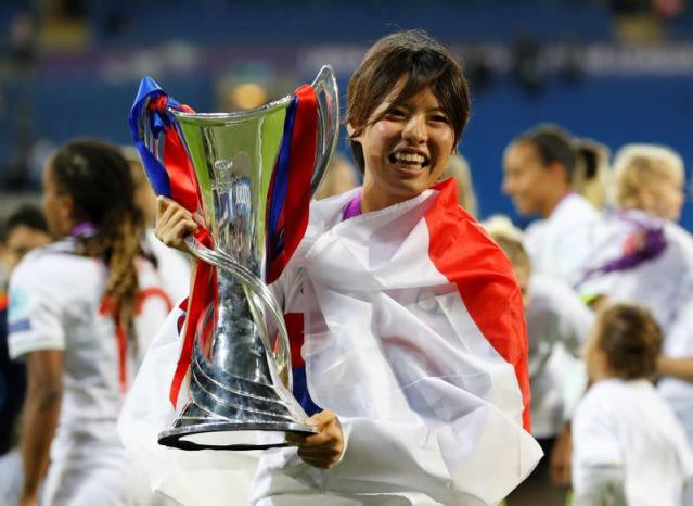 FILE PHOTO: Lyon's Saki Kumagai celebrates with the trophy after winning the UEFA Women's Champions League Final