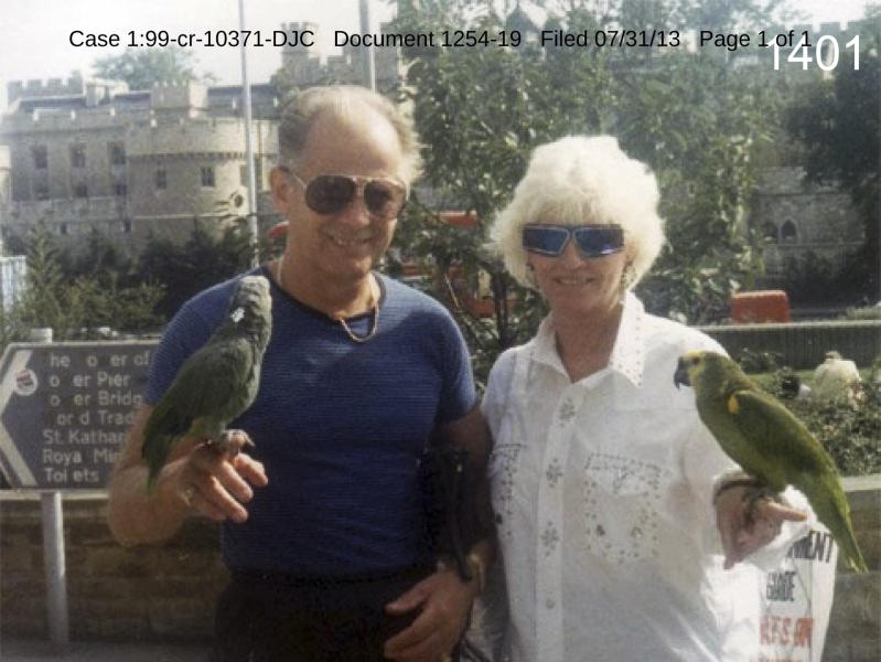 """This undated photo filed in federal court documents in Boston by defense attorneys for James """"Whitey"""" Bulger on Wednesday, July 31, 2013, shows Bulger with an unidentified woman holding birds in an unknown location. The photo was among several that showed a softer side of Bulger, which prosecutors complained were an attempt to salvage his reputation. Bulger, 83, is charged in a racketeering indictment with playing a role in 19 killings and multiple extortions during the 1970s and '80s when he alleged led the Winter Hill Gang. (AP Photo/Federal Court Documents)"""