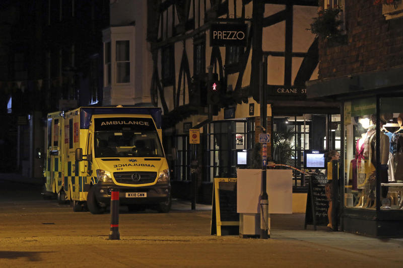 """Ambulances are parked outside the Prezzo restaurant in Salisbury, Britain, where police closed roads as a """"precautionary measure"""" after two people were taken ill from the restaurant, Sunday Sept. 16, 2018. Police closed roads and called a hazardous response team Sunday night after two people became ill at the restaurant in the English city where a Russian ex-spy and his daughter were poisoned with a chemical nerve agent. The conditions of a man and woman who got sick at the restaurant was under investigation. (Jonathan Brady/PA via AP)"""