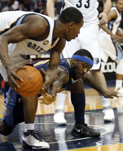 Memphis Grizzlies guard Tony Allen, left, pulls the ball away from Denver Nuggets guard Ty Lawson (3) in the first half of an NBA basketball game Tuesday, Jan. 31, 2012, in Memphis, Tenn. (AP Photo/Alan Spearman)