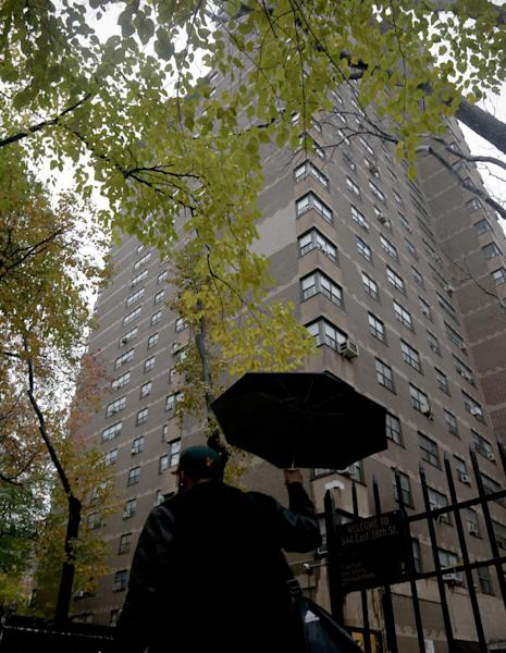 A person walks on Tuesday, Nov. 30, 2016, past the residential building in New York where police say Lapo Elkann, a grandson of the Italian founder of Fiat Automobiles, was arrested on Saturday. Elkann falsely claimed an escort held him against his will at the building. (AP Photo/Bebeto Matthews)