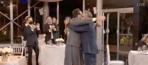 Schitts Creek Eugene Levy Daniel Levy celebrate with a hug