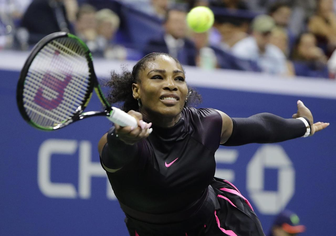 "FILE - In this Thursday, Sept. 8, 2016 file photo, Serena Williams returns a shot to Karolina Pliskova, of the Czech Republic, during the semifinals of the U.S. Open tennis tournament, in New York. Williams says she ""won't be silent"" about the killing of black men by police officers. Williams wrote on Facebook on Tuesday, Sept. 27, 2016, that she was inspired to speak out after asking her black 18-year-old nephew to drive her to a meeting. (AP Photo/Darron Cummings, File)"