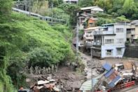 Pylons were toppled, vehicles buried and buildings tipped from their foundations in the landslide