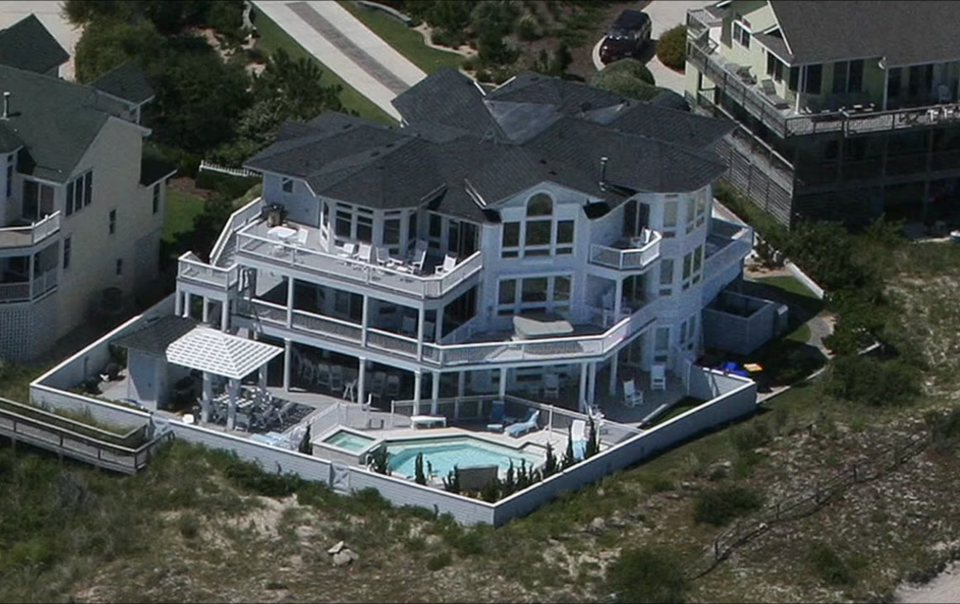 The family were staying in a luxurious beach house (pictured).