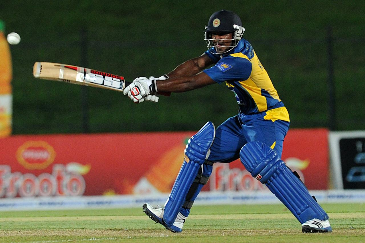 Sri Lankan cricketer Kushal Janith Perera plays a shot  during the opening one-day international (ODI) match between Sri Lanka and Bangladesh at The Suriyawewa Mahinda Rajapakse International Cricket Stadium in the southern district of Hambantota on March 23, 2013.  AFP PHOTO/ Ishara S. KODIKARA        (Photo credit should read Ishara S.KODIKARA/AFP/Getty Images)