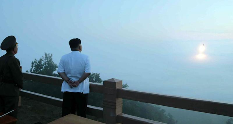 North Korean leader Kim Jong-Un (R) observing a tactical rocket launch in an undated picture released by KCNA on June 30, 2014 (AFP Photo/via KNS)