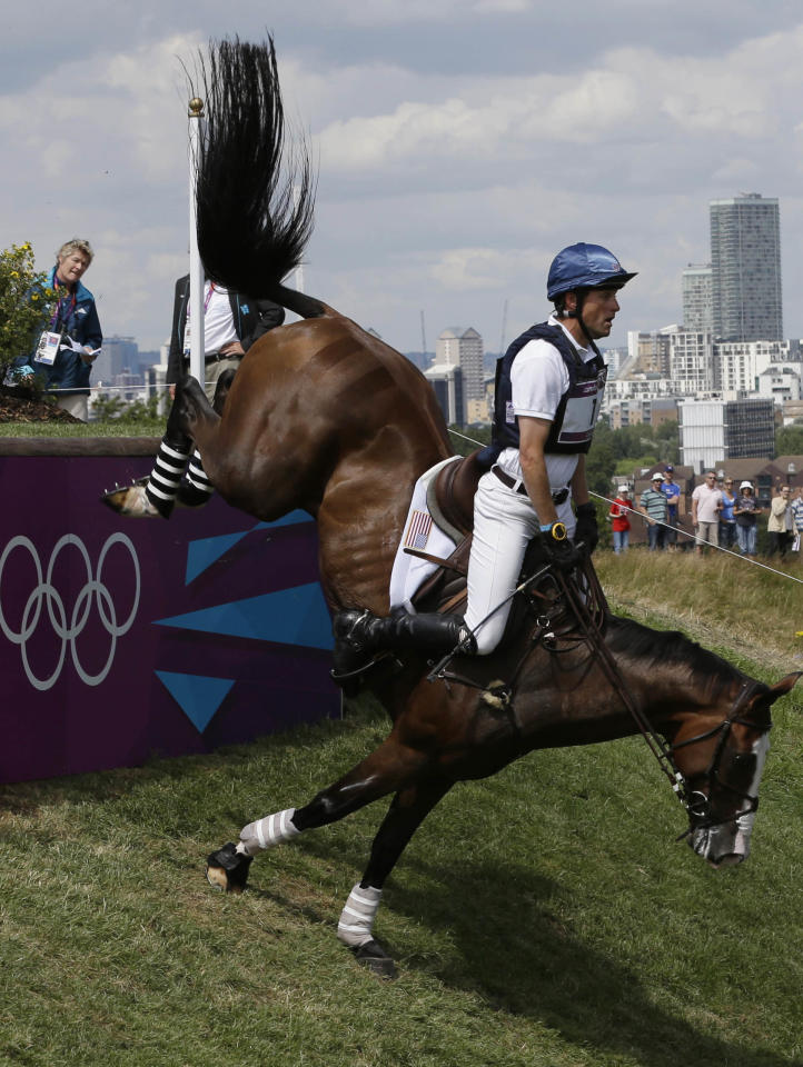 Boyd Martin of the United States competes with her horse Otis Barbotiere in the equestrian eventing cross country phase at Greenwich Park, at the 2012 Summer Olympics, Monday, July 30, 2012, in London. (AP Photo/)/Ng Han Guan)