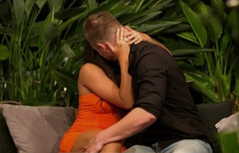 The pair are then seen getting hot and heavy in what appears to be a kiss. Source: Nine