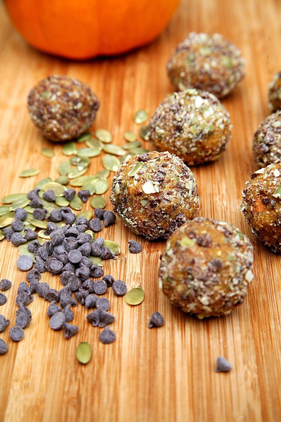 """<p>These vegan cookie-dough-like balls are rolled in chopped chocolate chips and pumpkin seeds, and offer 6.8 grams of protein for two balls.</p> <p><strong>Get the recipe:</strong> <a href=""""https://www.popsugar.com/fitness/Chocolate-Chip-Pumpkin-Protein-Balls-35959228"""" class=""""link rapid-noclick-resp"""" rel=""""nofollow noopener"""" target=""""_blank"""" data-ylk=""""slk:chocolate-chip pumpkin pie protein balls"""">chocolate-chip pumpkin pie protein balls</a></p>"""