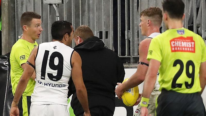 Carlton's Jack Newnes is pictured talking to the umpires prior to kicking a match-winning goal against Fremantle.