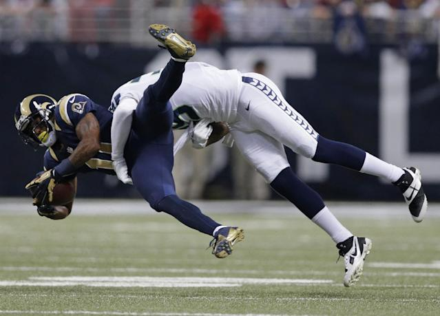 St. Louis Rams wide receiver Tavon Austin (11) gets tackled by Seattle Seahawks defensive end Cliff Avril (56) during the first half of an NFL football game, Monday, Oct. 28, 2013, in St. Louis. (AP Photo/Michael Conroy)