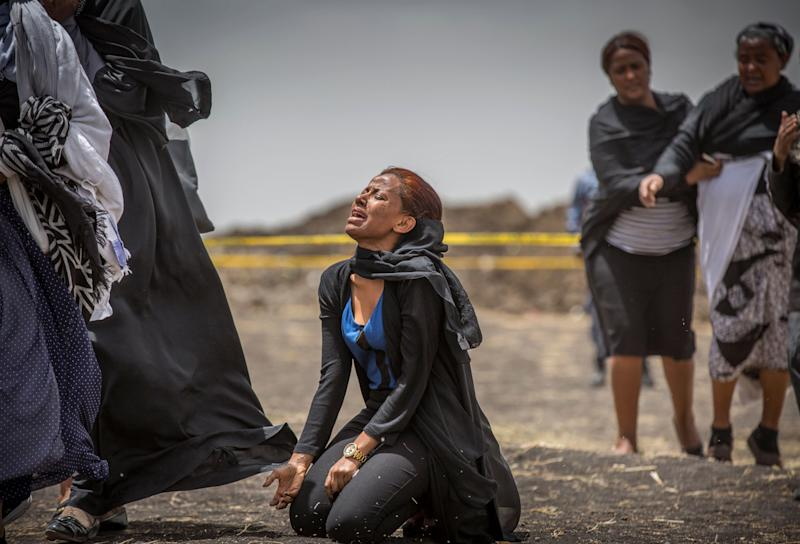 Ethiopian relatives of crash victims mourn and grieve at the scene where the Ethiopian Airlines Boeing 737 Max 8 crashed shortly after takeoff on Sunday killing all 157 on board, near Bishoftu, south-east of Addis Ababa, in Ethiopia Thursday, March 14, 2019. (Photo: Mulugeta Ayene/AP)