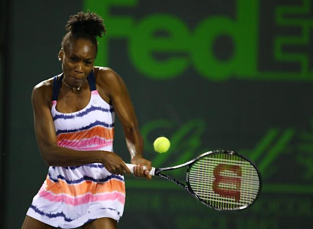 KEY BISCAYNE, FL - MARCH 21: Venus Williams of the USA returns a shot to Kimiko Date Krum of Japan during the Sony Open at Crandon Park Tennis Center on March 21, 2013 in Key Biscayne, Florida. (Photo by Al Bello/Getty Images)