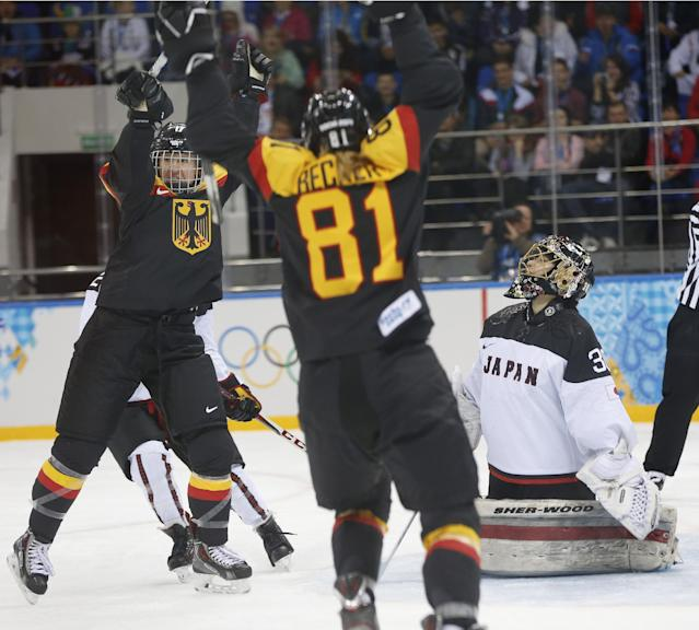 Goalkeeper Nana Fujimoto of Japan looks up as Team Germany celebrates Manuela Anwander's goal during the first period of the 2014 Winter Olympics women's ice hockey game at Shayba Arena, Thursday, Feb. 13, 2014, in Sochi, Russia. (AP Photo/Petr David Josek)