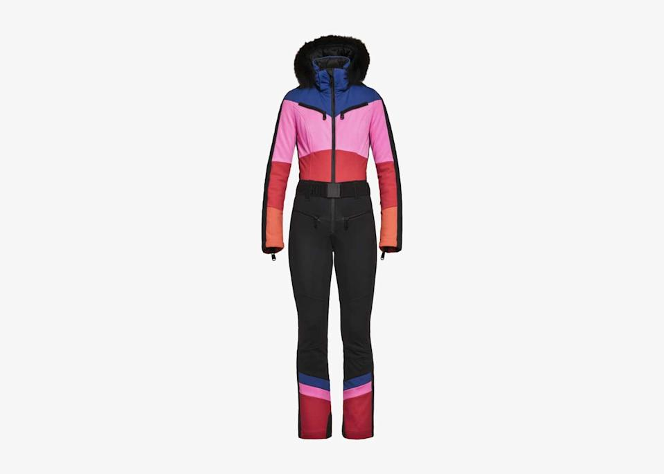 """This sleek, vintage-inspired suit is something a Bond villain might wear on the slopes. Colorful details add a bit of whimsy to the fitted silhouette, while a detachable fur collar—also available in <a href=""""https://www.goldbergh.com/en/pearl-jumpsuit-faux-fur-black-rainbow.html"""" rel=""""nofollow noopener"""" target=""""_blank"""" data-ylk=""""slk:faux fur"""" class=""""link rapid-noclick-resp"""">faux fur</a>—will add warmth when you need it. The stretchy and breathable softshell suit is sporty enough to work on the mountain, and stylish enough to wear to your favorite <a href=""""https://www.cntraveler.com/story/best-new-restaurants-in-new-york-city?mbid=synd_yahoo_rss"""" rel=""""nofollow noopener"""" target=""""_blank"""" data-ylk=""""slk:outdoor dining spot"""" class=""""link rapid-noclick-resp"""">outdoor dining spot</a>. $1093, Goldbergh. <a href=""""https://www.goldbergh.com/en/pearl-jumpsuit-real-fox-fur-black-rainbow.html"""" rel=""""nofollow noopener"""" target=""""_blank"""" data-ylk=""""slk:Get it now!"""" class=""""link rapid-noclick-resp"""">Get it now!</a>"""