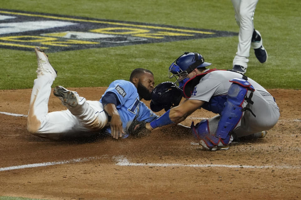 Tampa Bay Rays' Manuel Margot is tagged out at home by Los Angeles Dodgers catcher Austin Barnes trying to steal during the fourth inning in Game 5 of the baseball World Series Sunday, Oct. 25, 2020, in Arlington, Texas. (AP Photo/Tony Gutierrez)