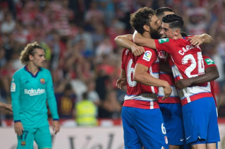 Granada players celebrate at the end of their stunning win over Antoine Griezmann and Barcelona