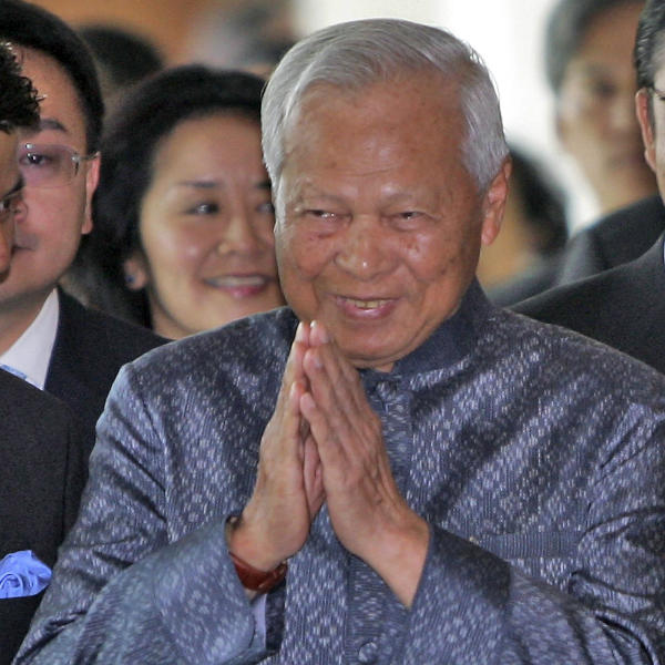 FILE - In this May 26, 2006 file photo, Prem Tinsulanonda, then chief advisor to King Bhumibol Adulyadej greets others on his arrival at the Thailand Ministry of Foreign Affairs in Bangkok. Prem Tinsulanonda, one of Thailand's most influential political figures over four decades who served as army commander, prime minister and adviser to the royal palace, has died at age 98. Thai media reported he died Sunday morning, May 26, 2019, in a Bangkok hospital, and an official announcement is expected. (AP Photo/David Longstreath, File)