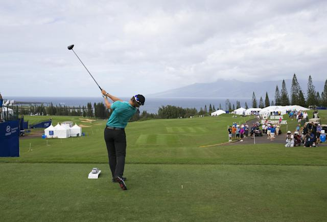 Dererk Ernst tees off the first hole during the first round of Tournament of Champions golf tournament, Friday, Jan. 3, 2014, in Kapalua, Hawaii. (AP Photo/Marco Garcia)