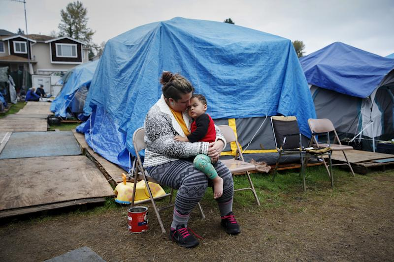 Kadee Ingram, 28, holds her son Sean, 2, at SHARE/WHEEL Tent City 3 outside Seattle. The Employee Hours Tax would have provided just under $50 million in funding to fight homelessness.