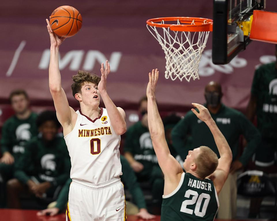 Minnesota Gophers center Liam Robbins (0) shoots the ball over Michigan State Spartans forward Joey Hauser (20) on Dec. 28, 2020, during the first half at Williams Arena.