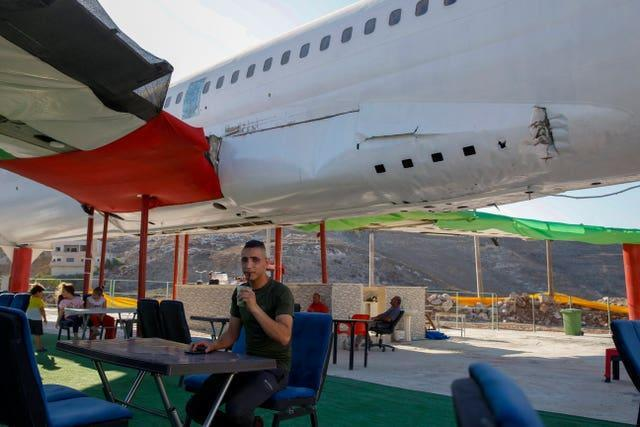Palestinians visit a Boeing 707 aircraft after it was converted to a cafe restaurant, in Wadi Al-Badhan, near the West Bank city of Nablus