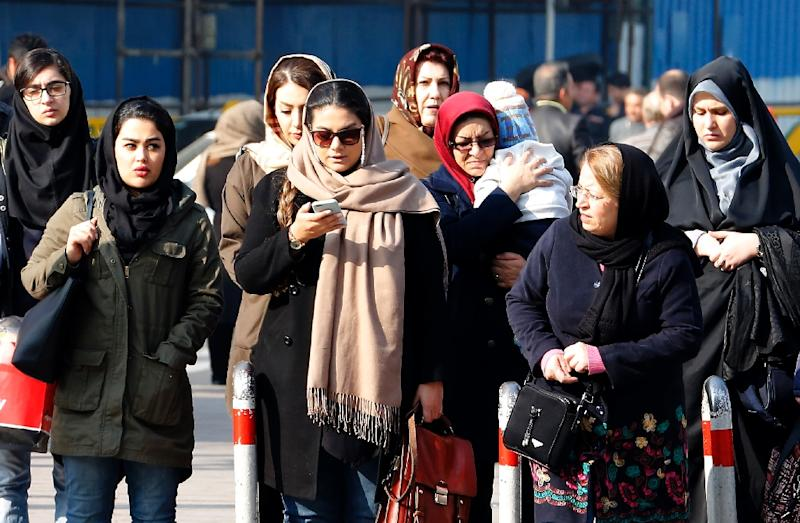 Rules require women in Iran to wear a headscarf and dress modestly, but it is unremarkable now to see women in tight jeans with loose head coverings (AFP Photo/ATTA KENARE)
