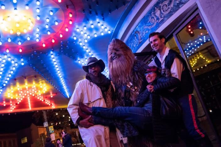 Fans arrive at the Grand Lake Theater for the opening of the final chapter of the Skywalker saga 'Star Wars: The Rise of Skywalker' in Oakland