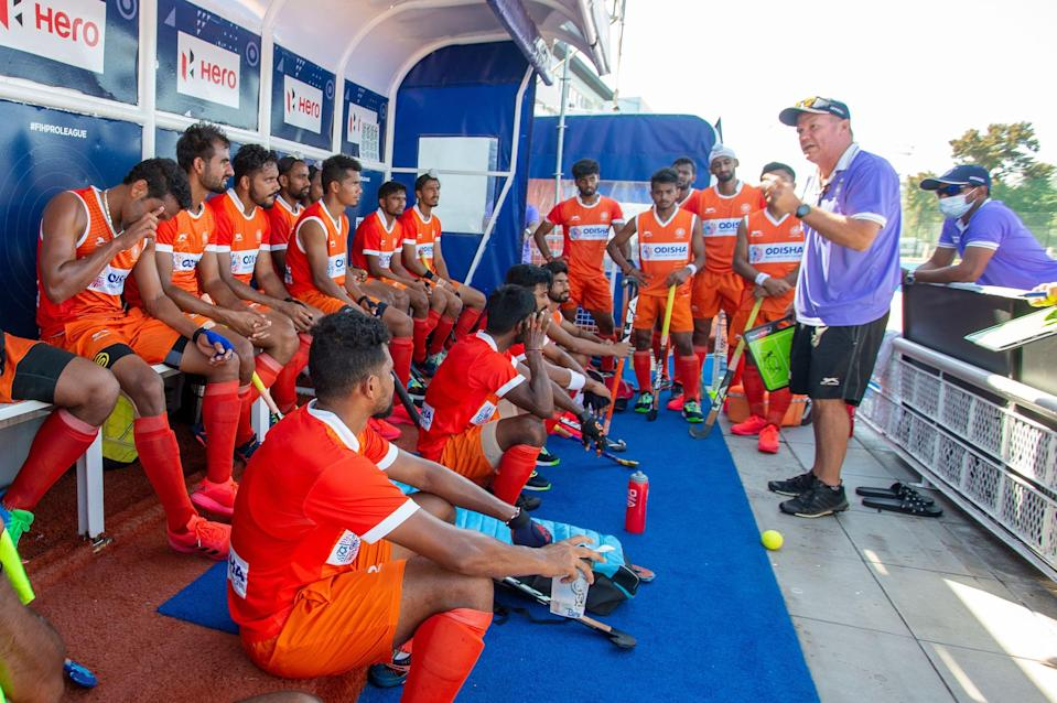 The Indian men's hockey team having a discussion with the coach Graham Reid.