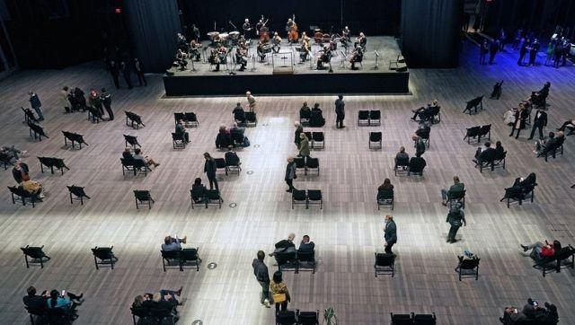 Concertgoers take their seats before a live performance of the New York Philharmonic, which performed for the first time since 10 March, 2020, at The Shed in Hudson Yards, Wednesday, 14 April, 2021, in New York. Photo via The Associated Press/Kathy Willens