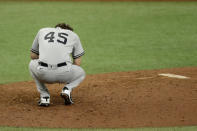 New York Yankees starting pitcher Gerrit Cole reacts after giving up a two-run home run to Tampa Bay Rays' Jose Martinez during the fifth inning of the first game of a doubleheader baseball game Saturday, Aug. 8, 2020, in St. Petersburg, Fla. (AP Photo/Chris O'Meara)