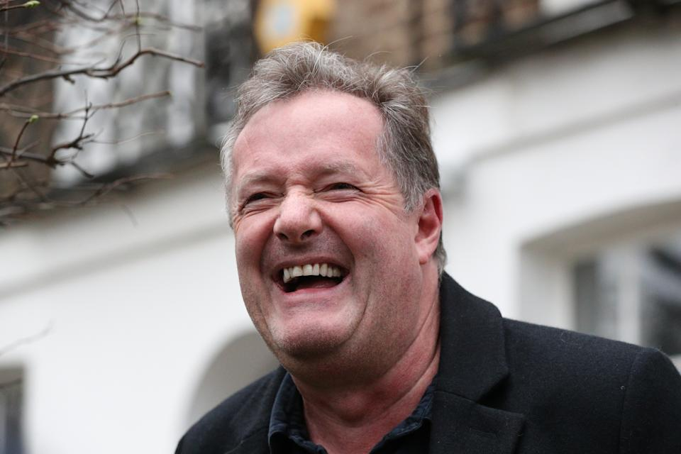 Piers Morgan laughs as he speaks to reporters outside his home in Kensington, central London, the morning after it was announced by broadcaster ITV that he was leaving as a host of Good Morning Britain. Picture date: Wednesday March 10, 2021.