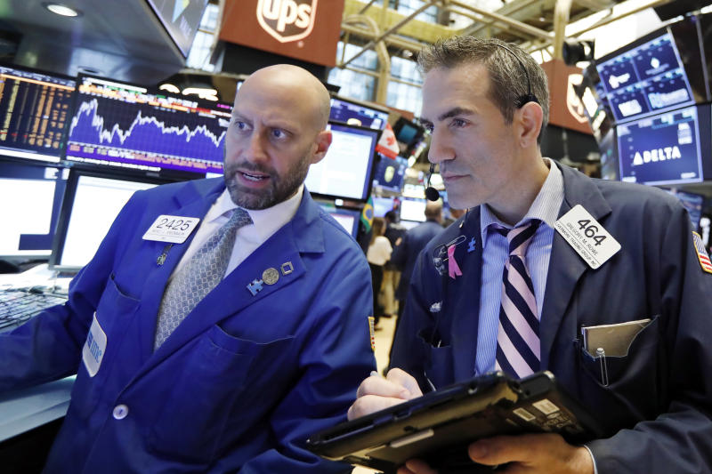 S&P, Dow lifted by financials; Microsoft pressures Nasdaq