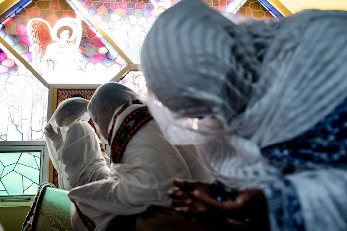 Members of the Ethiopian community take part in a special prayer for the victims of the Ethiopian Airlines flight ET302 crash, at the Ethiopian Orthodox Tewahedo Church of Canada Saint Mary Cathedral in Toronto, March 10, 2019. (Photo: Christopher Katsarov/The Canadian Press via AP)