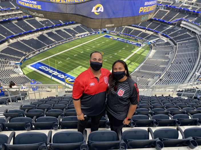 Rams fans Alfredo and Whitney Lopez at SoFi Stadium.