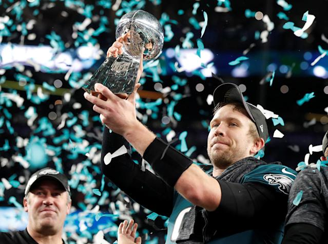 NFL Football - Philadelphia Eagles v New England Patriots - Super Bowl LII - U.S. Bank Stadium, Minneapolis, Minnesota, U.S. - February 4, 2018 Philadelphia Eagles' Nick Foles celebrates with the Vince Lombardi Trophy after winning Super Bowl LII as head coach Doug Pederson looks on REUTERS/Kevin Lamarque