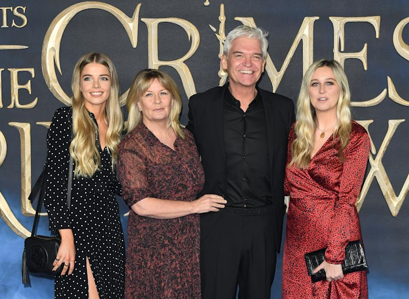 "Stephanie Lowe (2nd L), Phillip Schofield (2nd R) and family attend the UK Premiere of ""Fantastic Beasts: The Crimes Of Grindelwald"" at Cineworld Leicester Square on November 13, 2018 in London, England. (Photo by Karwai Tang/WireImage)"